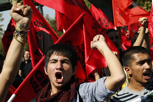 Protesters shout slogans as they march during a protest against Turkey's government in Ankara