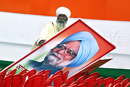A Congress supporter with Prime Minister Manmohan Singh after an election rally in Punjab