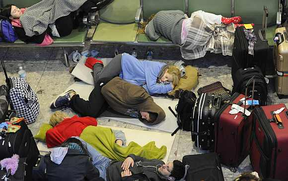 Passengers sleep on makeshift beds in Terminal 3 at Heathrow Airport in west London