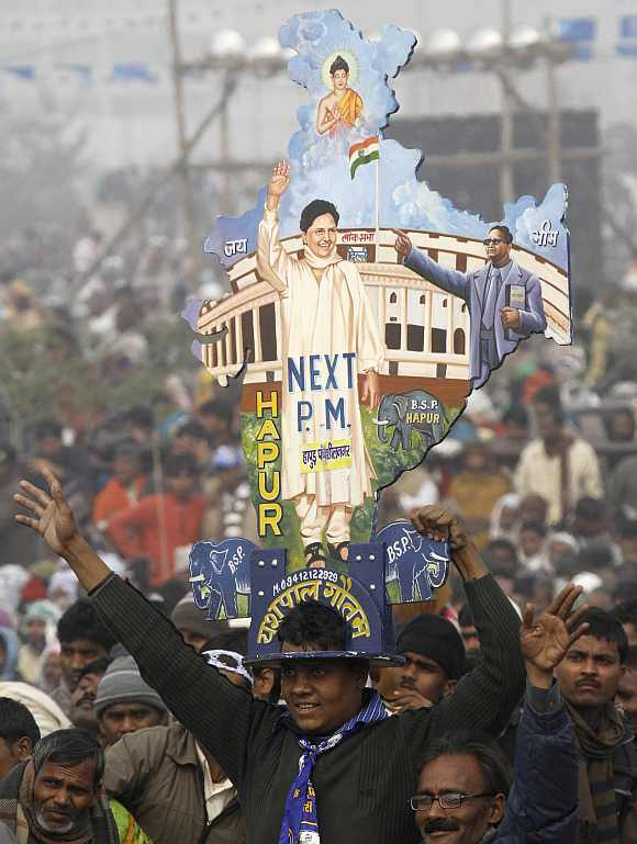 A supporter holds a cutout of the map of India with images of UP Chief Minister Mayawati and BR Ambedkar in Lucknow