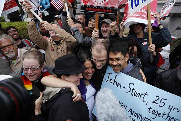 Gay marriage advocates cheer after news of the Proposition 8 over-ruling outside the Ninth Circuit Courthouse in San Francisco, California