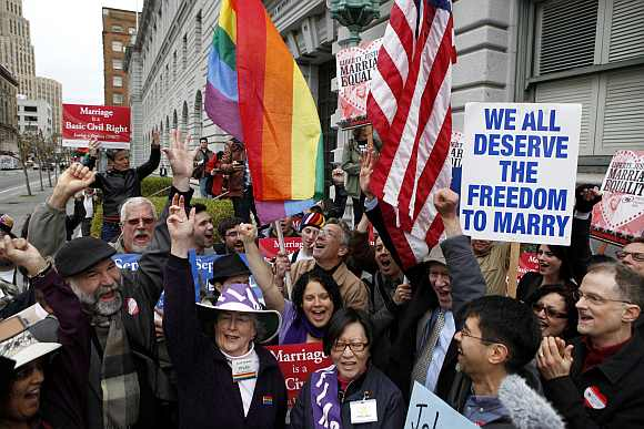 Gay Marriage advocates cheer during a rally moments before hearing the news of the Proposition 8 over-ruling outside the Ninth Circuit Courthouse in San Francisco, California