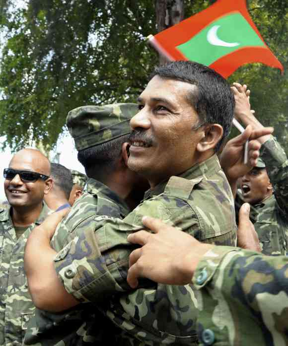 Maldives soldiers after they joined police in a protest in Male
