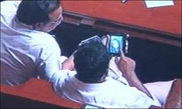 The ministers were filmed watching porn in the assembly