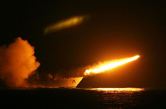 A surface-to-air missile is fired from a naval warship to intercept a surface-to-surface missile
