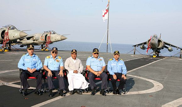 Defence Minister A K Antony flanked by the Navy Chief Admiral Nirmal Verma and the C-in-C, Eastern Naval Command, Vice Admiral Anil Chopra aboard INS Viraat