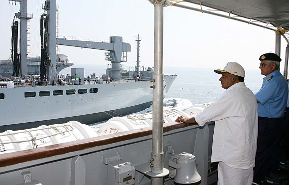 Defence Minister A K Antony and Navy Chief Admiral Nirmal Verma aboard INS Shivalik, watching replenishing at sea, during Naval Exercise TROPEX-2012