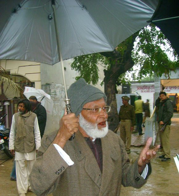 Mohammad Qazi speaks to the media outside a polling station in Barabanki