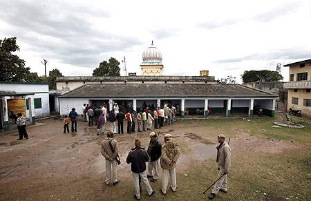 Voters outside a polling station in Ayodhya, UP