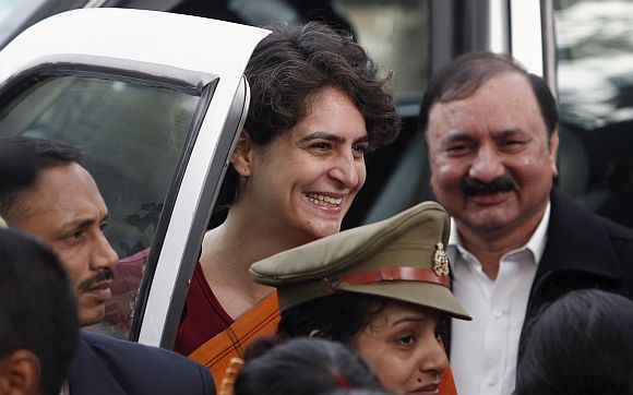 Priyanka Gandhi Vadera smiles as she meets supporters of Congress party during a stopover at Rae Bareli district as part of her election campaign in UP