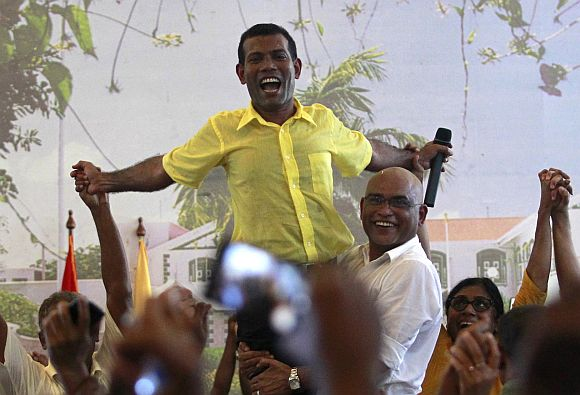 Ousted Maldivian President Mohamed Nasheed is carried by his supporters during the Maldivian Democratic Party's meeting in Male