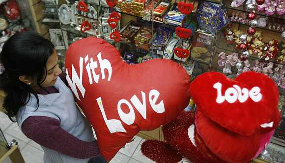 A girl looks for gifts at a shop ahead of Valentine's Day celebrations