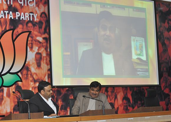 Gadkari with Arvind Gupta, convener of the National IT Cell of the BJP
