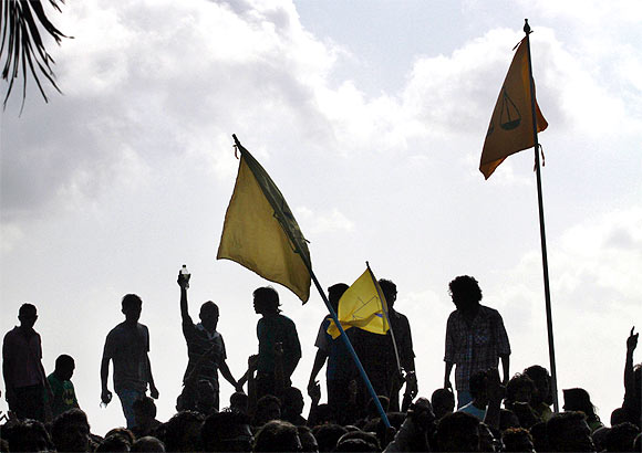 Supporters of ousted Maldivian President Mohamed Nasheed march during a protest in Male