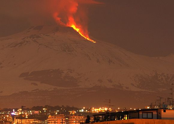 Mount Etna spews lava on the southern Italian island of Sicily