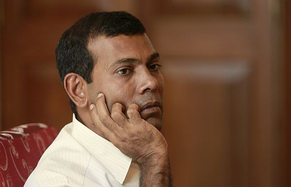 Ousted Maldivian president Mohammed Nasheed speaks to the media in Male