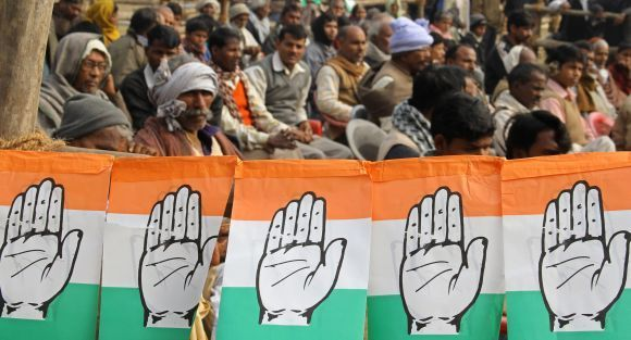 Congress supporters listen to Rahul Gandhi during a campaign rally in UP