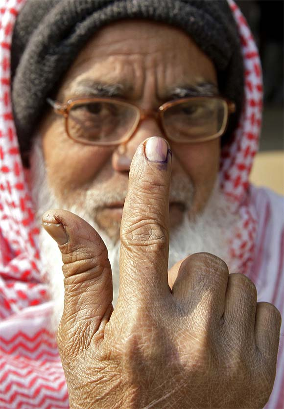 A voter shows his ink-marked finger after casting his vote in Gorakhpur
