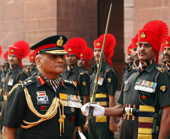 Then army chief General V K Singh inspects a guard of honour in New Delhi.