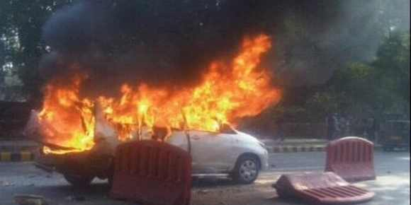 An Israel diplomat's car goes up in flames after an explosion in New Delhi on Monday