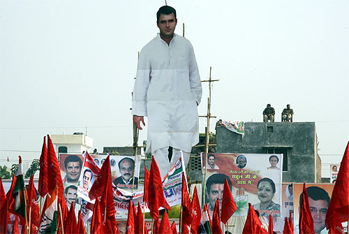 A giant cut-out of Rahul Gandhi on the roof of a house near the venue of a Congress campaign rally in Allahabad