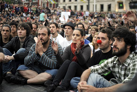 Crowds listen to speeches during a protest in the Plaza Arriaga in Bilbao, Spain
