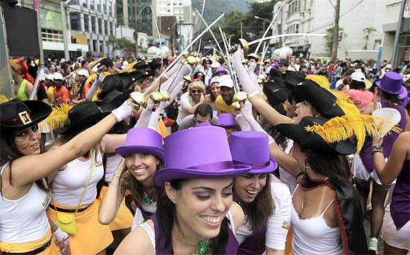 Revellers attend a samba parade during pre-carnival festivities in Rio de Janeiro