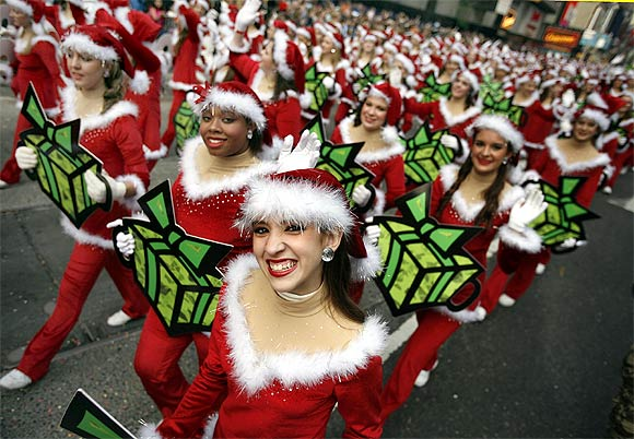 Elves walk through Times Square during a parade in New York