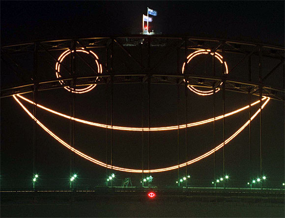 A giant smile lights up Sydney's Harbour Bridge