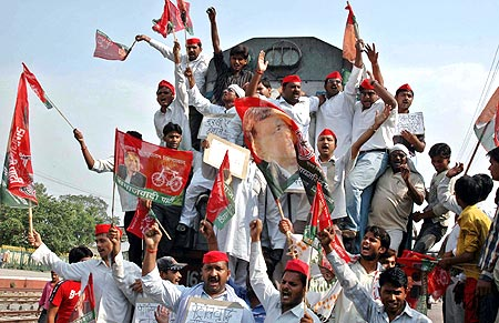 Activists from the Samajwadi Party protesting against the hike in oil prices at Prayag railway station in Allahabad