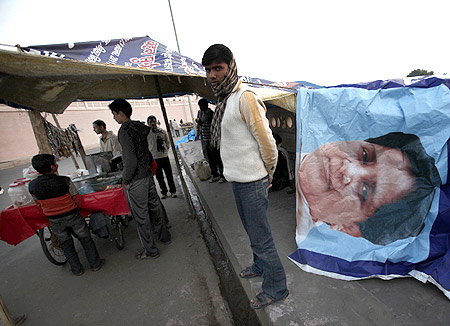 A tea stall vendor uses a banner of UP Chief Minister Mayawati to cover his roadside shop in Lucknow