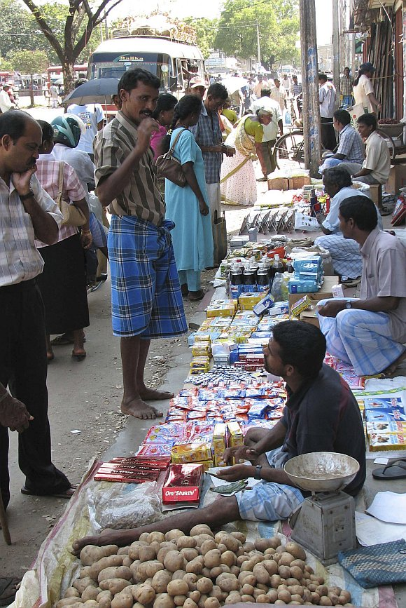 An ethnic Tamil street vendor sells his wares in Jaffna