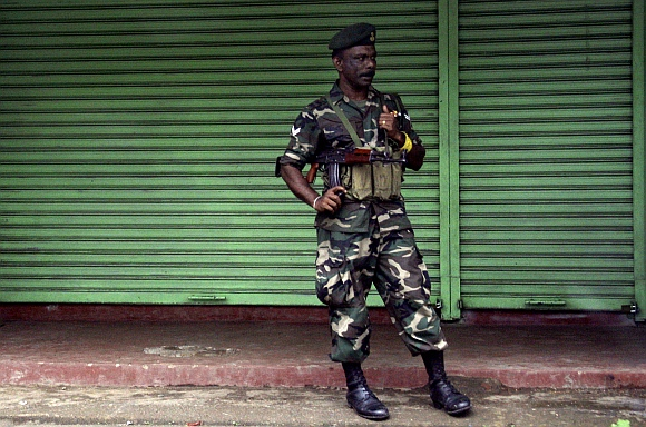 A Sri Lanka government soldier stands guard on a street in central Colombo