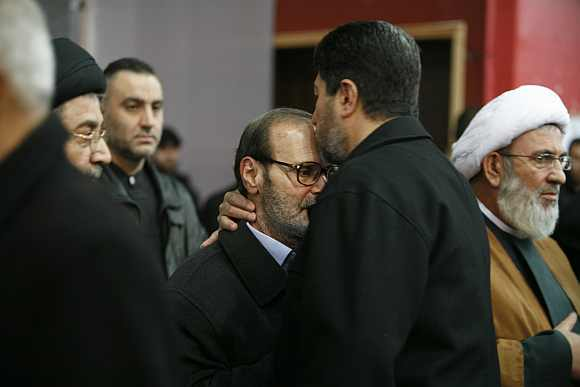 Fayez Moughniyeh, father of Lebanon's Hezbollah assassinated commander Imad Moughniyeh, receives condolence during his son's funeral in Beirut on February 14, 2008
