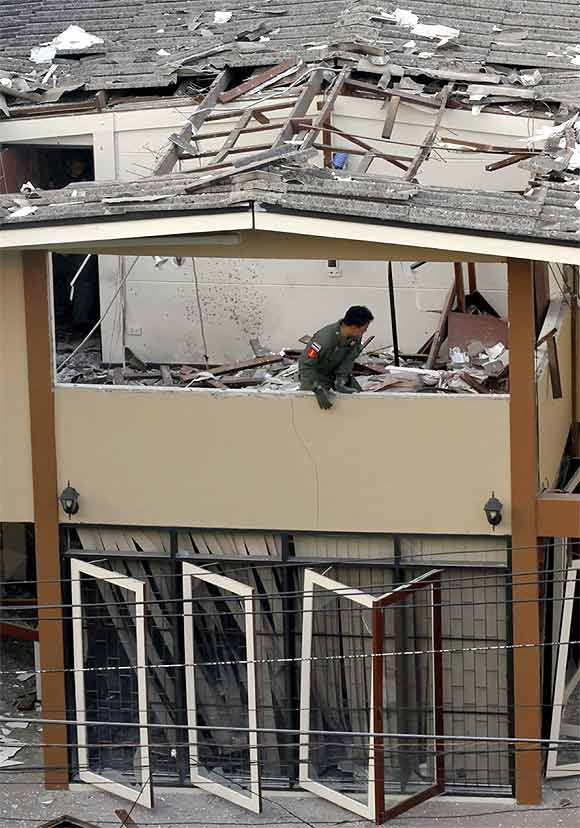 A police expert works at the site of an explosion in Ekamai area in central Bangkok