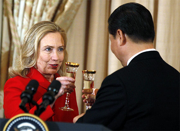 US Secretary of State Hillary Clinton toasts to China's Vice President Xi Jinping at a luncheon at the State Department in Washington, February 14
