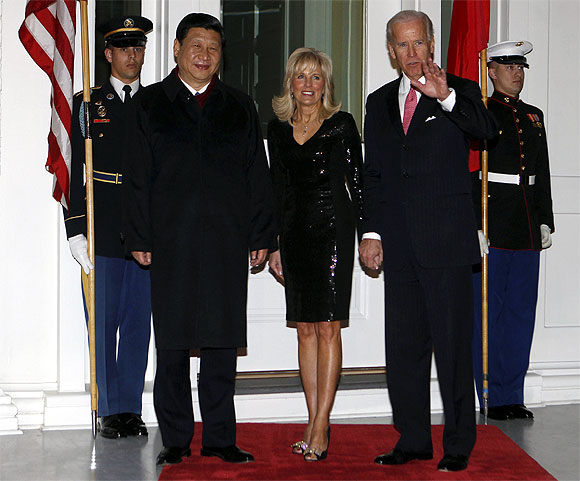 US Vice President Joe Biden and his wife Jill welcome Xi Jinping before a formal dinner at the vice president's residence in Washington