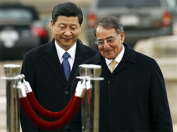 Xi Jinping and US Secretary of Defence Leon Panetta walk together at an arrival ceremony at the Pentagon in Washington February 14
