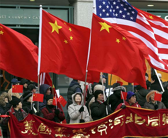 China supporters holding Chinese and US flags gather near the White House in Washington during the visit of Chinese Vice President Xi Jinping