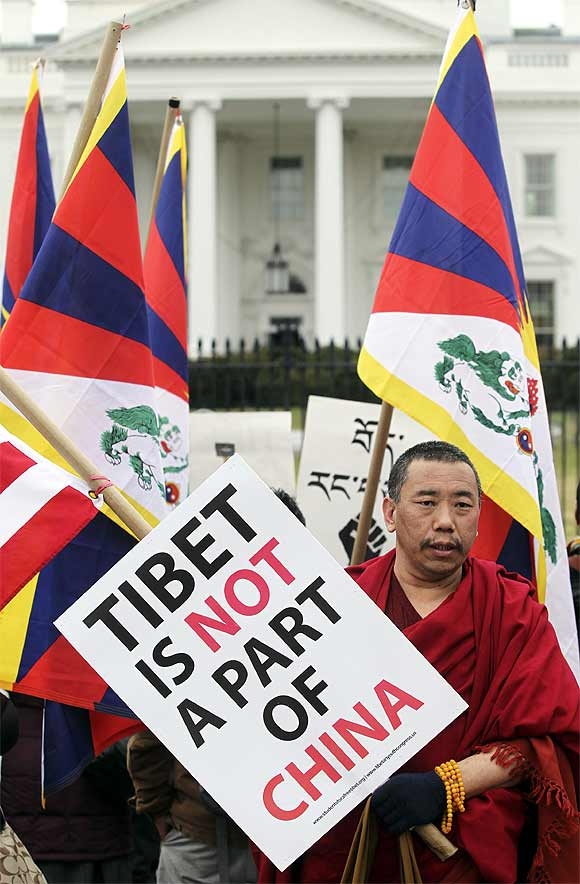A Buddhist monk participates in a protest during the visit of Xi Jinping, in front of the White House in Washington