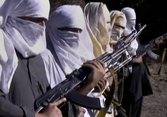 Pakistani Taliban fighters hold weapons as they receive training in Ladda, South Waziristan tribal region, in this still image taken from a video
