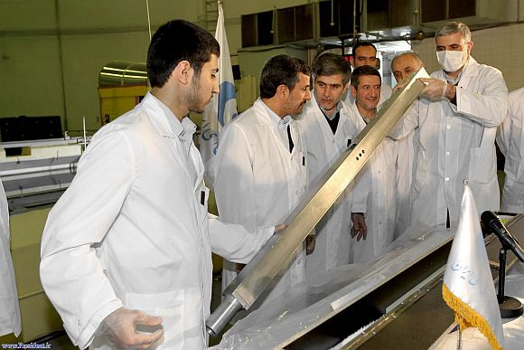 Iran's President Mahmoud Ahmadinejad (2nd L) attends the unveiling ceremony of new nuclear projects in Tehran
