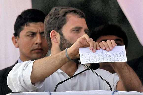 Rahul Gandhi tore up a paper with a list of election promises of political opponents at a rally in Lucknow on Wednesday