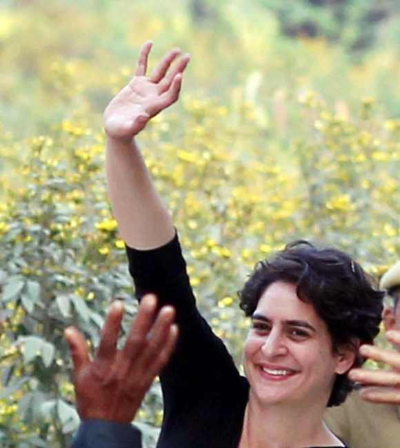 Priyanka Gandhi waves at her supporters in Rae Bareli