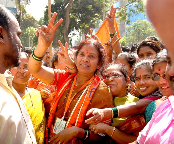 A Shiv Sena winning candidate celebrates her victory