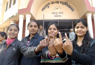 Voters outside a polling booth in Lucknow