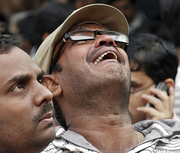 A man weeps as he watches patients being evacuated from AMRI hospital after it caught fire in Kolkata