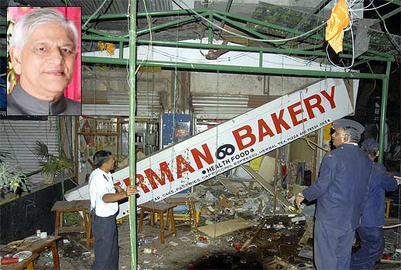Firefighters examine the site of a bomb blast at the German Bakery restaurant in Pune in February, 2010. (Inset) C D Sahay