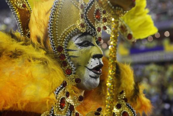 A reveller from the Porto da Pedra samba school parades on the first night of the annual Carnival parade in Rio de Janeiro's Sambadrome