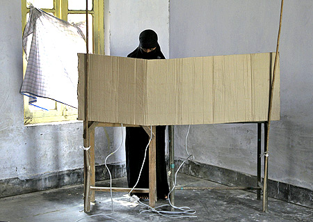 A woman casts her vote in Azamgarh, UP.